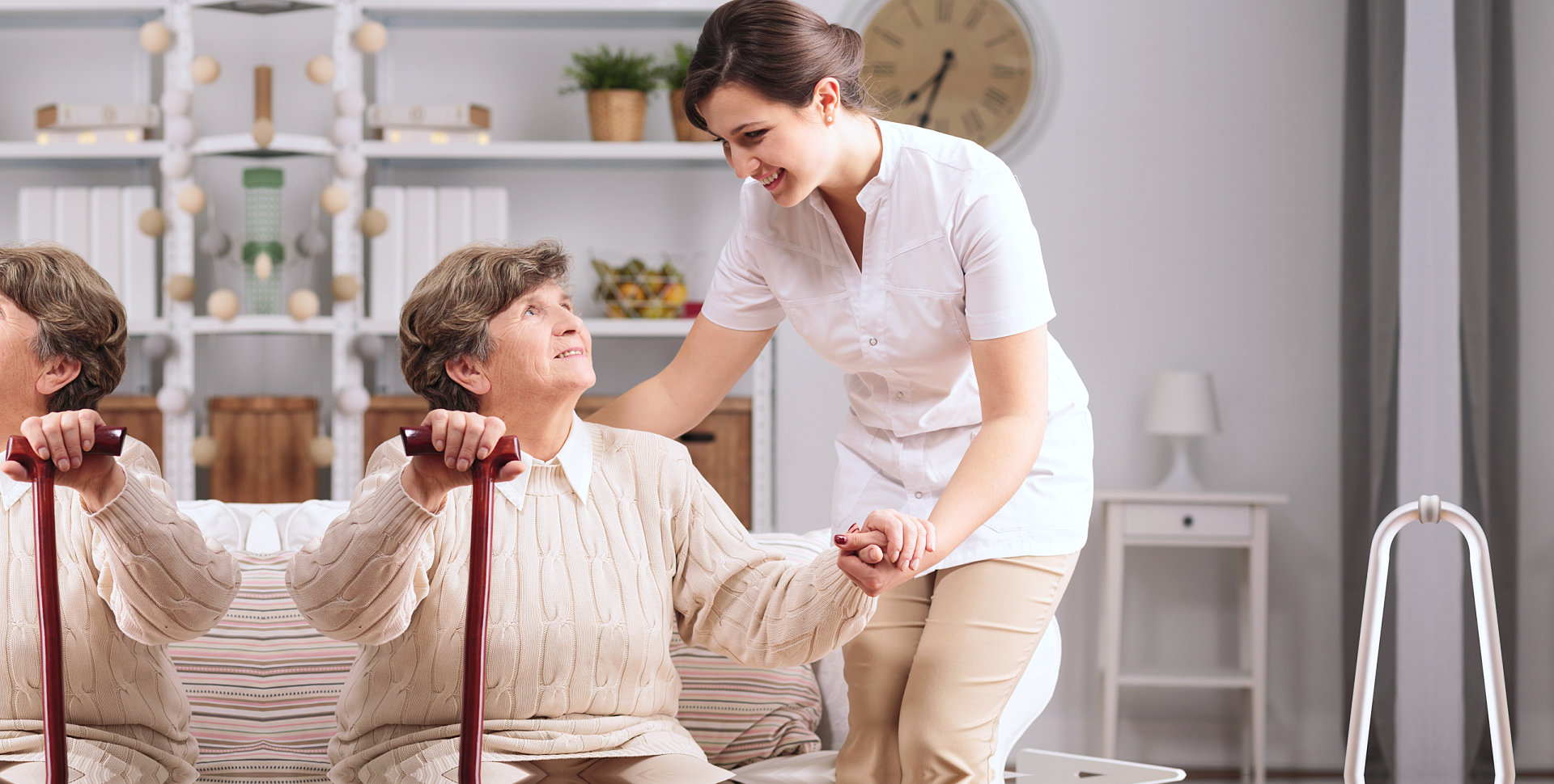 elder woman assisted by caregiver