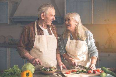elderly couple preparing food concept