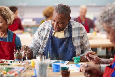 retired elder man attending art class