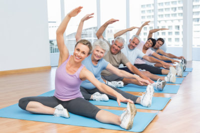 group of elderly during yoga session with instructor