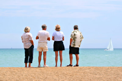 group of elderly looking at the open sea