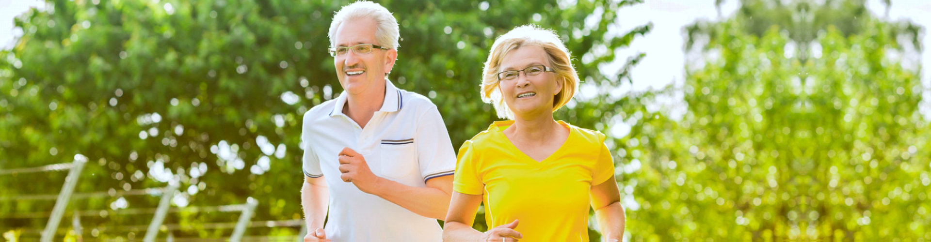 elderly couple running on the park